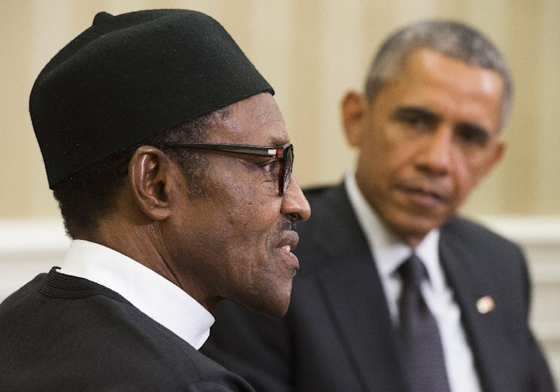 US President Barack Obama meets with Nigerian President Muhammadu Buhari in the Oval Office of the White House in Washington, DC on July 20, 2015 (AFP Photo/Saul Loeb)