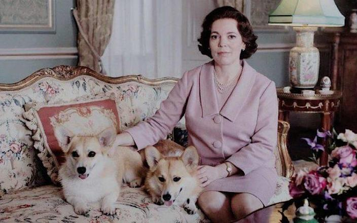 Olivia Colman, who took over the role of Queen Elizabeth from Claire Foy for Season 3 of The Crown, with some of her co-stars, including the Pembroke Welsh Corgis - Netflix