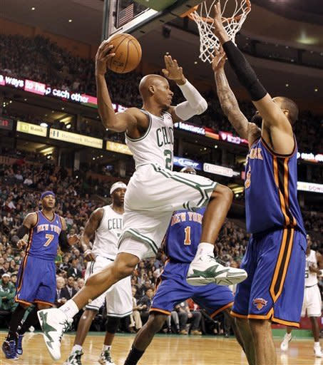 Boston Celtics' Ray Allen looks for an opening around New York Knicks' Tyson Chandler during the first quarter of an NBA basketball game in Boston on Friday, Feb. 3, 2012. (AP Photo/Winslow Townson)