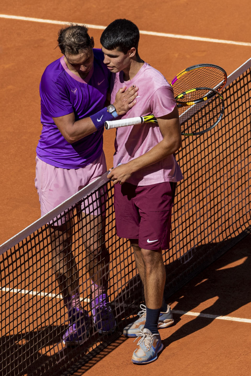 Spain's Rafael Nadal, left, and Spain's Carlos Alcaraz after their match at the Mutua Madrid Open tennis tournament in Madrid, Spain, Wednesday, May 5, 2021. (AP Photo/Bernat Armangue)