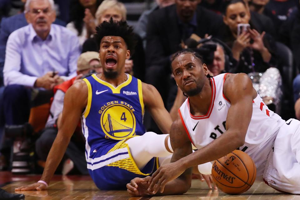 Quinn Cook #4 of the Golden State Warriors and Kawhi Leonard #2 of the Toronto Raptors react in the second quarter during Game One of the 2019 NBA Finals at Scotiabank Arena on May 30, 2019 in Toronto, Canada. (Photo by Gregory Shamus/Getty Images)