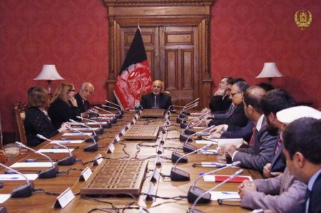 Afghanistan's President Ashraf Ghani (C) talks with the U.S. special envoy for peace in Afghanistan, Zalmay Khalilzad (L), during a meeting in Kabul, Afghanistan January 27, 2019. Presidential Palace office/Handout via REUTERS