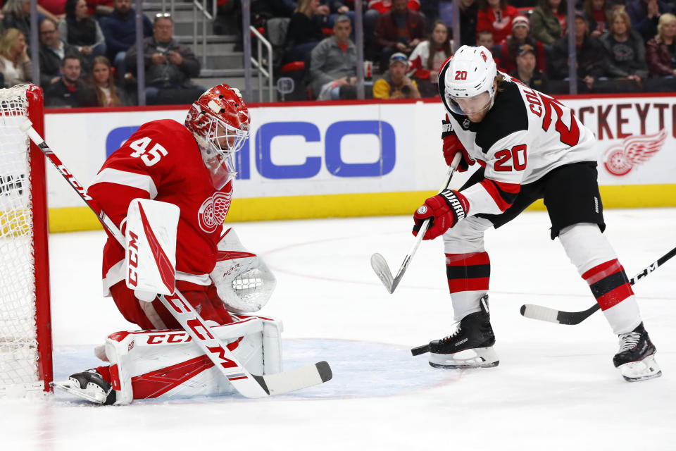 Detroit Red Wings goaltender Jonathan Bernier (45) stops a shot by New Jersey Devils center Blake Coleman (20) during the first period of an NHL hockey game Friday, March 29, 2019, in Detroit. (AP Photo/Paul Sancya)