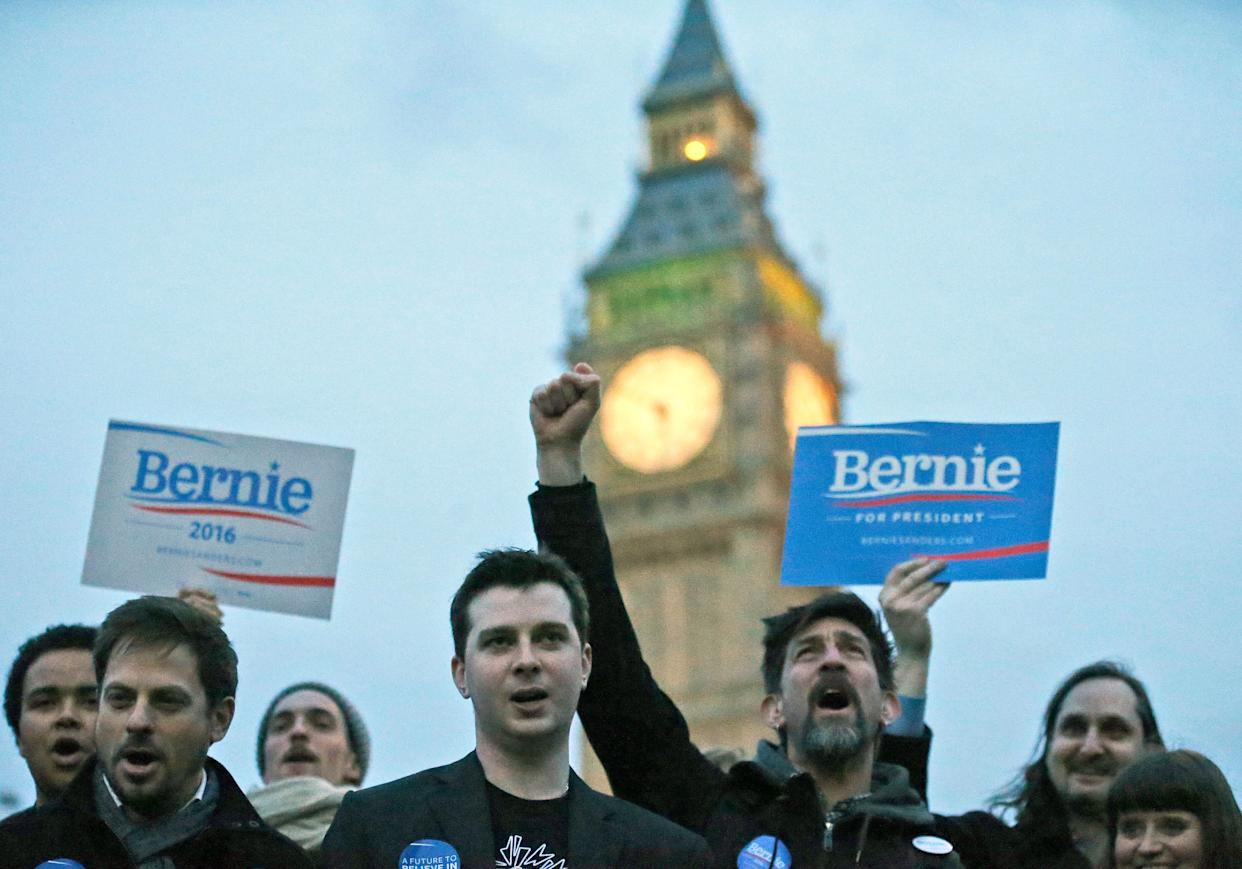 Supporters of democratic candidate Bernie Sanders gather in London, Tuesday, March 1, 2016 as voting begins in the U.S. Democrats Abroad Global Presidential Primary.(AP Photo/Frank Augstein)