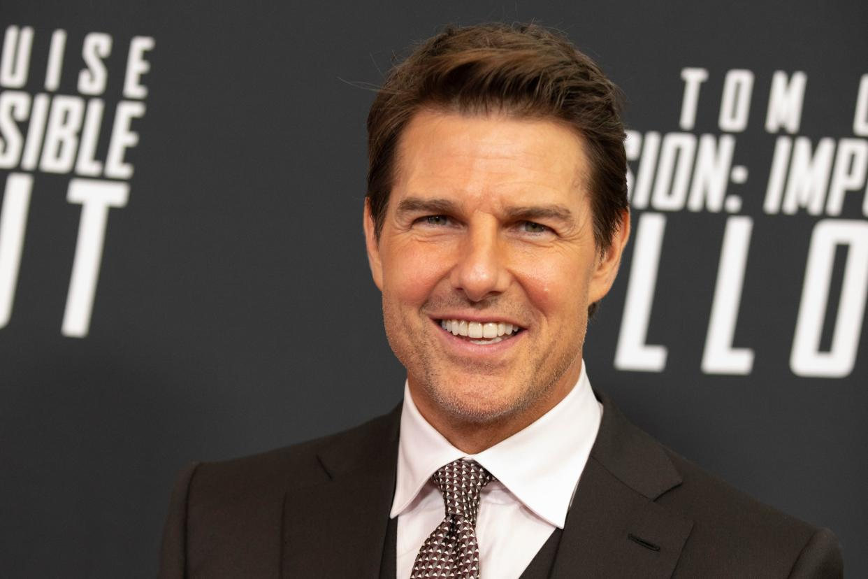 """Actor and Producer Tom Cruise arrives for a screening of """"Mission Impossible - Fallout"""" at the Smithsonian National Air and Space Museum on July 22, in Washington, DC. (Photo by Alex Edelman / AFP)        (Photo credit should read ALEX EDELMAN/AFP via Getty Images)"""