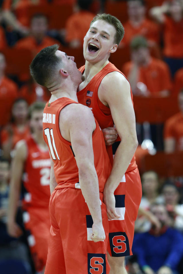 Syracuse guard Buddy Boeheim (35) celebrates a there point play with teammate Syracuse guard Joseph Girard III (11) during the second half of an NCAA college basketball game in Charlottesville, Va., Saturday, Jan. 11, 2020. Syracuse defeated Virginia 63-55 in overtime. (AP Photo/Steve Helber)