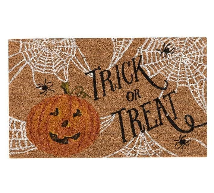 <p>Deck out your porch for the season with this <span>Trick or Treat Light Up Doormat</span> ($39).</p>