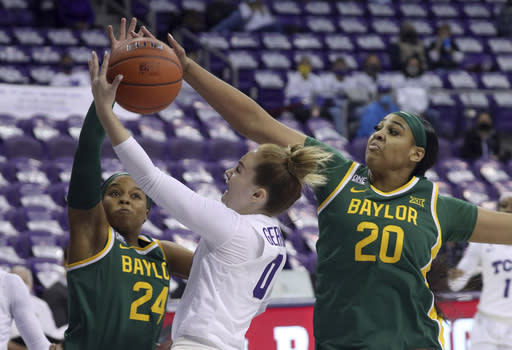 Baylor guard Sarah Andrews (24) and center Hannah Gusters (20) defend against a shot by TCU guard Caroline Germond (0) in the first half of an NCAA college basketball game, Saturday, Jan. 2, 2021. (AP Photo/ Richard W. Rodriguez)
