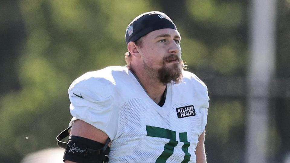 Jets Alex Lewis on field at practice