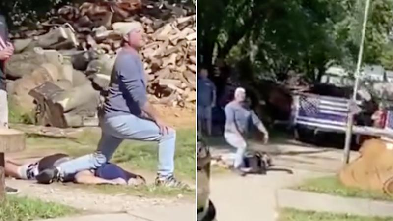A man kneeling on the neck of another man shouting at Black Lives Matters protesters was filmed