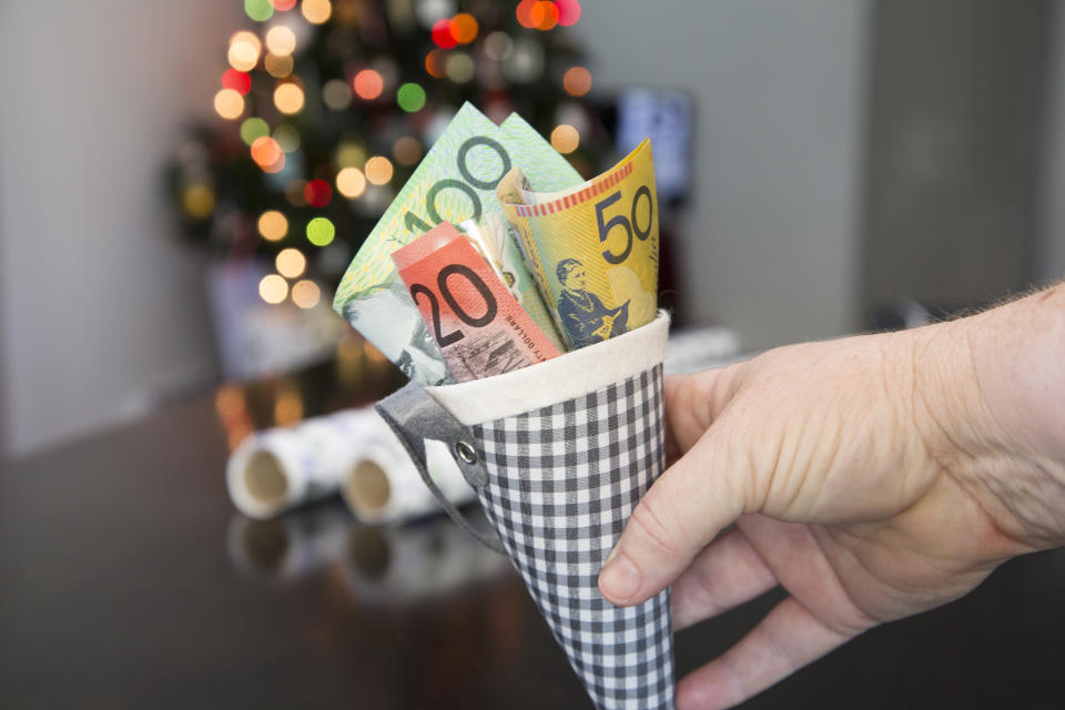 A Christmas cone filled with Australian money, $100, $50, $20