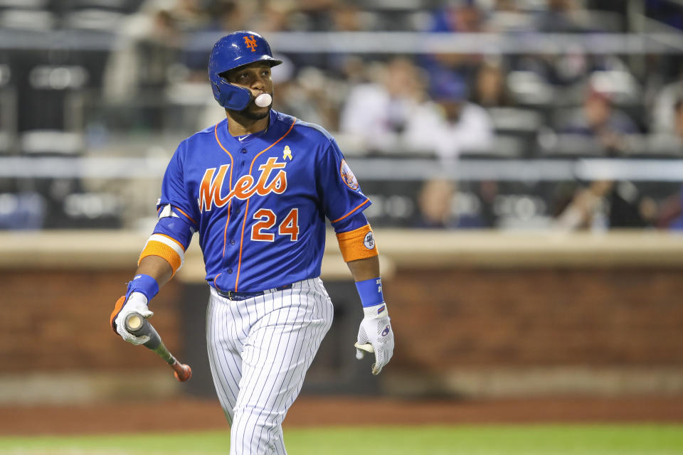 New York Mets' pinch hitter Robinson Cano walks off the field after striking out during the ninth inning of a baseball game against the Philadelphia Phillies, Saturday, Sept. 7, 2019, in New York. (AP Photo/Mary Altaffer)