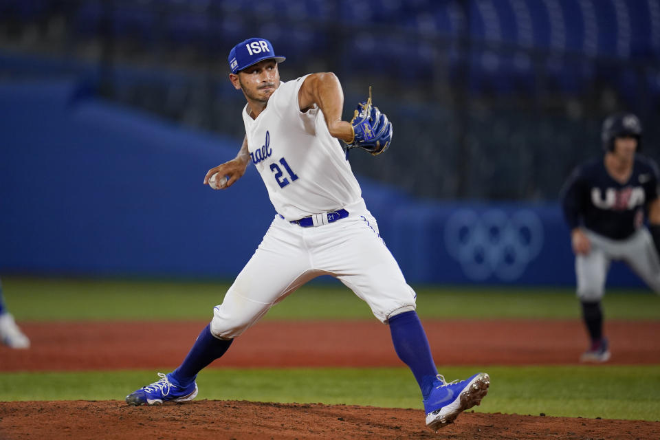 Israel's Jonathan De Marte pitches during the sixth inning of a baseball game against the United States at the 2020 Summer Olympics, Friday, July 30, 2021, in Yokohama, Japan. (AP Photo/Sue Ogrocki)