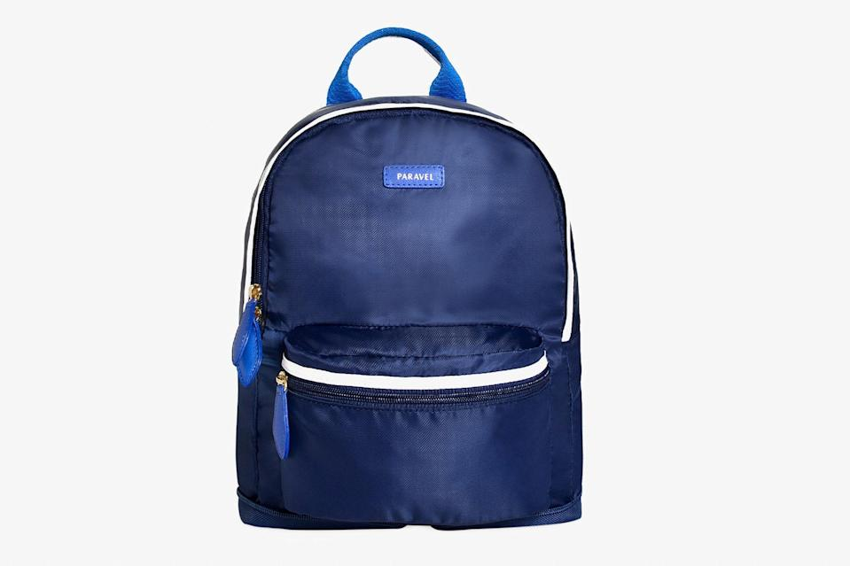 """Ideal for everything from city excursions to last-minute souvenir shopping, <a href=""""https://www.cntraveler.com/story/paravel-fold-up-duffel-bag?mbid=synd_yahoo_rss"""" rel=""""nofollow noopener"""" target=""""_blank"""" data-ylk=""""slk:Paravel"""" class=""""link rapid-noclick-resp"""">Paravel</a>'s lightweight backpack folds up so small that it will take up hardly any space in your suitcase—perfect for those of us who tend to buy too much on vacation. Bonus: It's crafted out of the brand's earth-friendly """"negative nylon,"""" which is made from recycled plastic water bottles. $45, Paravel. <a href=""""https://tourparavel.com/products/mini-fold-up-backpack"""" rel=""""nofollow noopener"""" target=""""_blank"""" data-ylk=""""slk:Get it now!"""" class=""""link rapid-noclick-resp"""">Get it now!</a>"""