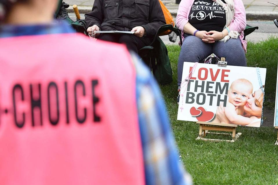 Pro-choice demonstrators (foreground) face pro-life demonstrators outside an abortion clinic (PA)