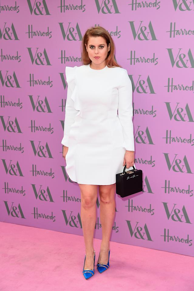 <p>It's been a non-stop week for Princess Beatrice, who donned her second party outfit of the week in a ruddle white mini dress with blue heels with a cute box bag.<br />[Photo: Getty] </p>