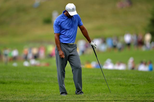 ARDMORE, PA - JUNE 13: Tiger Woods of the United States reacts to his second shot on the second hole during Round One of the 113th U.S. Open at Merion Golf Club on June 13, 2013 in Ardmore, Pennsylvania. (Photo by Drew Hallowell/Getty Images)