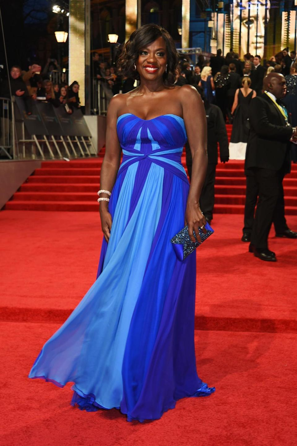 <p>Viola was hard to miss in a bright blue strapless number. <i>[Photo: Getty]</i> </p>
