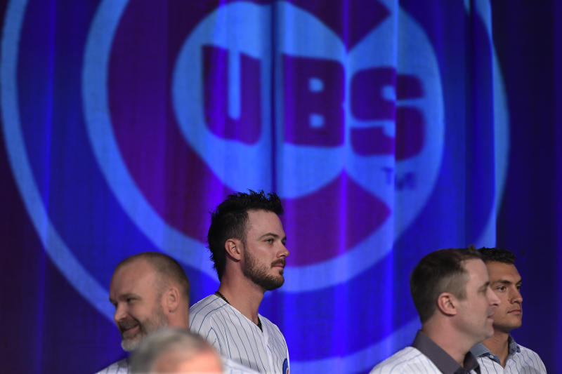 Chicago Cubs' Kris Bryant, center, looks on during the baseball team's convention, Friday, Jan. 17, 2020, in Chicago. (AP Photo/Paul Beaty)