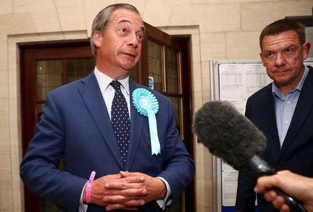 Brexit Party leader Nigel Farage speaks to the media outside the counting centre for the European Parliamentary election in Southampton, Britain, May 26, 2019. REUTERS/Hannah McKay