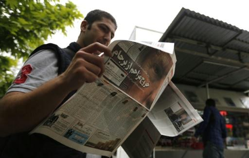 An Iranian man checks a newspaper in Tehran on May 9, 2018 a day after the US pulled out of the nuclear deal