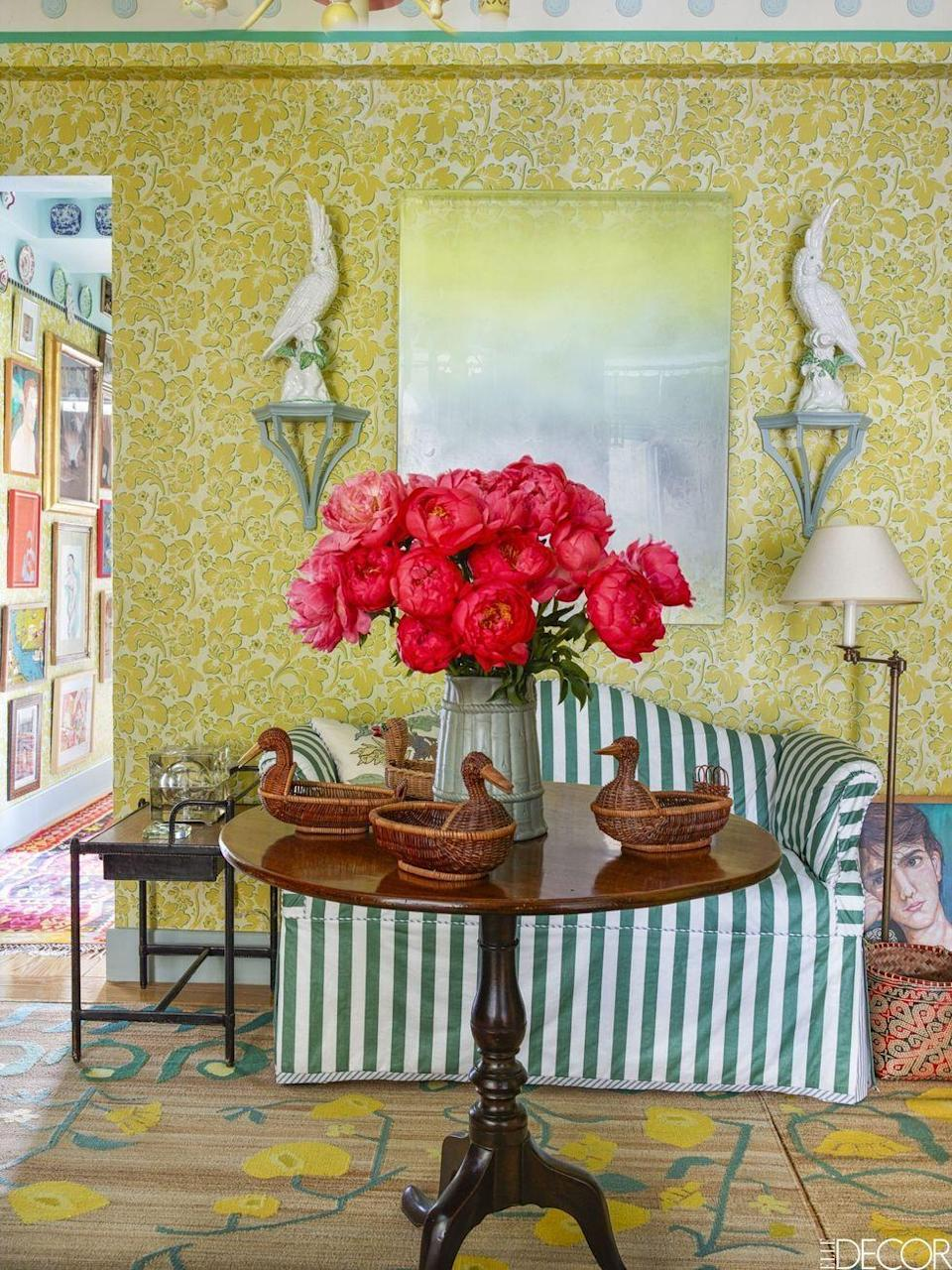 """<p>In the entry hall of a <a href=""""https://www.elledecor.com/design-decorate/house-interiors/a8881/beautiful-new-york-apartment/"""" rel=""""nofollow noopener"""" target=""""_blank"""" data-ylk=""""slk:grand New York apartment"""" class=""""link rapid-noclick-resp"""">grand New York apartment</a>, the settee is covered in a Rose Cumming fabric, the late-18th-century Philadelphia table is a family heirloom, and the hand-painted yellow floral wallpaper is by San Patrignano.</p><p><em>Plume Wallpaper, $98</em><br><a class=""""link rapid-noclick-resp"""" href=""""https://go.redirectingat.com?id=74968X1596630&url=https%3A%2F%2Fwww.anthropologie.com%2Fshop%2Fplume-wallpaper2%3Fcolor%3D071%26size%3DOne%2BSize%26inventoryCountry%3DUS%26countryCode%3DUS%26mrkgcl%3D694%26mrkgadid%3D3339968734%26adtype%3Dpla%26product_id%3D42867457%26adpos%3D1o2%26creative%3D348156566303%26device%3Dc%26network%3Dg%26gclid%3DCjwKCAjw8NfrBRA7EiwAfiVJpYVHaIRrLSd6xXLFbHomsNvPH3SwYuncKT5S03p4TIsyls4F8tWUcxoC9EoQAvD_BwE%26gclsrc%3Daw.ds%26type%3DSTANDARD%26quantity%3D1&sref=https%3A%2F%2Fwww.redbookmag.com%2Fhome%2Fg35083191%2Fwallpaper-design-ideas%2F"""" rel=""""nofollow noopener"""" target=""""_blank"""" data-ylk=""""slk:Shop the Look"""">Shop the Look</a></p>"""