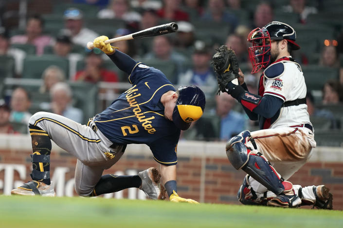 Milwaukee Brewers' Luis Urias (2) avoids a ball at the plate pitched by Atlanta Braves relief pitcher Tyler Matzek (68) during the eighth inning of Game 4 of a baseball National League Division Series, Tuesday, Oct. 12, 2021, in Atlanta. (AP Photo/Brynn Anderson)