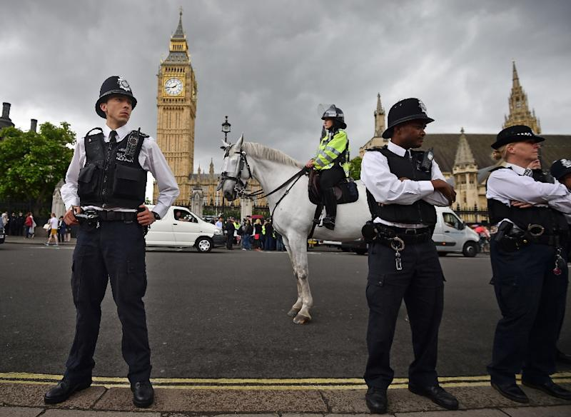 Police stand guard in Parliament Square in central London, on July 8, 2015 (AFP Photo/Ben Stansall)