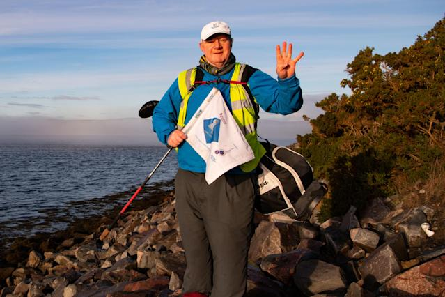 "<div class=""caption""> Edmund with his Global Golf 4 Cancer flag </div> <cite class=""credit"">Matthew Harris</cite>"