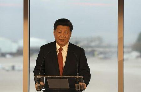 China's President Xi Jinping addresses dignitaries at Manchester airport in Britain