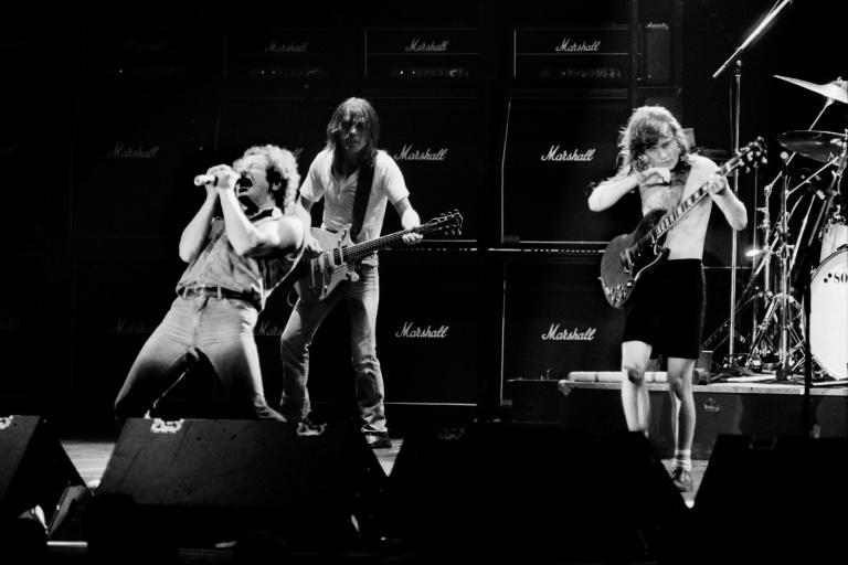 This file photo shows singer Brian Johnson performing next to guitarists Malcolm Young and Angus Young of Australian legendary hard rock band AC/DC at the Palais Omnisport of Paris Bercy, on September 15, 1984 in Paris