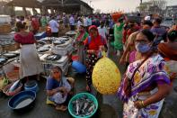 People are seen at a fish market, amidst the spread of the coronavirus disease (COVID-19), in Mumbai