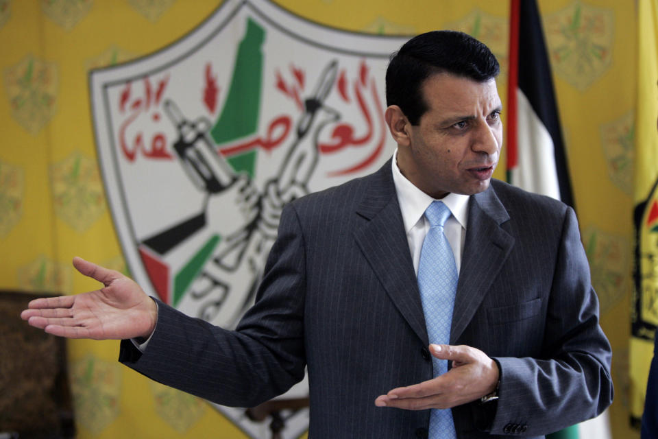 FILE - In this Jan. 3, 2011 file photo, then Palestinian Fatah leader Mohammed Dahlan gestures in his office in the West Bank city of Ramallah. Afghan President Ashraf Ghani, driven out by the Taliban, is the latest leader on the run to turn up in the United Arab Emirates. Others who found refuge in the Gulf Arab state include Palestinian Mohammed Dahlan, who was banished by his party and sentenced to prison, ex-Pakistani Prime Minister Benazir Bhutto, Spain's King Juan Carlos who is facing financial probe and former Thai prime ministers. (AP Photo/Majdi Mohammed, File)