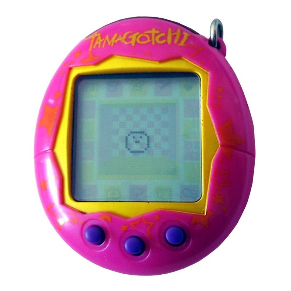 "<p><a class=""link rapid-noclick-resp"" href=""https://www.amazon.com/Tamagotchi-mini-Blue-with-Pink/dp/B073M31F43/ref=sr_1_1?tag=syn-yahoo-20&ascsubtag=%5Bartid%7C10063.g.34738490%5Bsrc%7Cyahoo-us"" rel=""nofollow noopener"" target=""_blank"" data-ylk=""slk:BUY NOW"">BUY NOW</a><br></p><p>The egg-shaped keychain that doubled as a handheld digital pet was one of the biggest fads of the '90s. Released in 1997, the Tamagotchi had three buttons that allowed you to grow your little species into a full adult. The same year, the virtual pet craze was escalated with the release of Giga Pets, Tamagotchi's competitor. Tamagotchis later resurfaced in 2004 with the new Tamagotchi Plus.</p>"