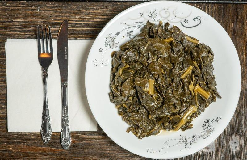 Plate of Collard Greens on wooden table