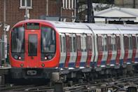 <p>A tube train at Parsons Green station in the minutes after the explosion. (PA) </p>