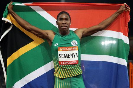 Caster Semenya of South Africa celebrates victory. REUTERS/Athit Perawongmetha