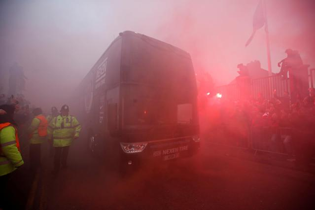 <p>Soccer Football – Champions League Quarter Final First Leg – Liverpool vs Manchester City – Anfield, Liverpool, Britain – April 4, 2018 Liverpool fans set off flares as the Manchester City team bus arrives outside the stadium before the match Action Images via Reuters/Carl Recine </p>