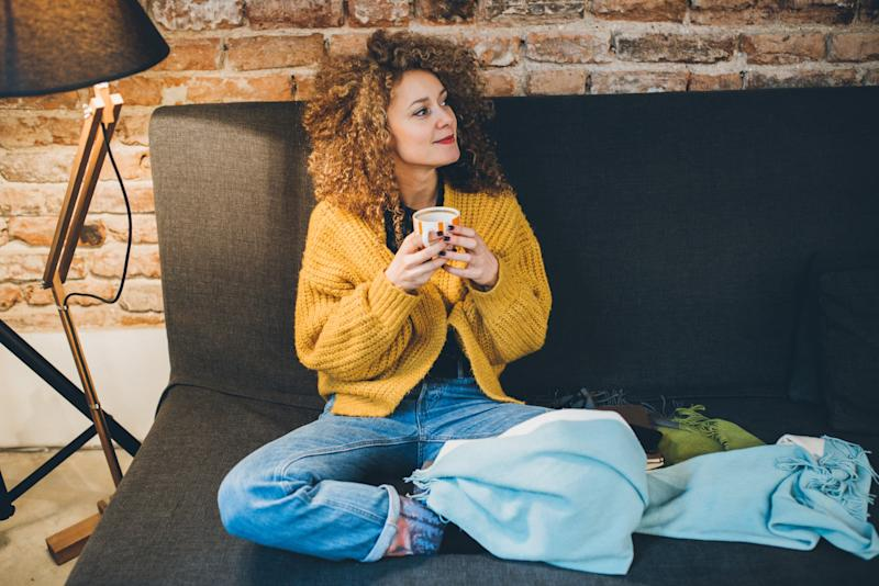 Woman drinking some coffee on the sofa