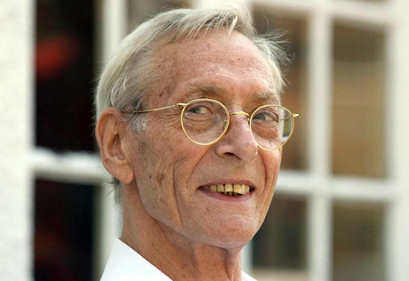 FILE- Bruce Reynolds the mastermind of the August 1963 Great Train Robbery seen in this file photo dated Aug. 9, 2003, in London.  Reynolds, the mastermind of the infamous Great Train Robbery heist has died Thursday Feb. 28, 2013, aged 81.  Reynolds was part of the gang that stole 2.6 million pounds (US dlrs 3.95 million) from a Glasgow-to-London mail train, then Britain's biggest robbery, he evaded capture for five years but was arrested and sentenced to 25-years in jail. (AP Photo / Matthew Fearn, PA, FILE) UNITED KINGDOM OUT - NO SALES - NO ARCHIVES