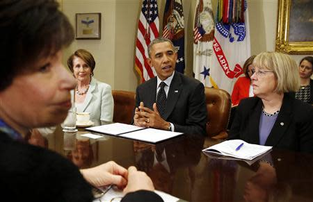 U.S. President Barack Obama speaks to female members of Congress about his administration's minimum wage efforts in the Roosevelt Room at the White House in Washington
