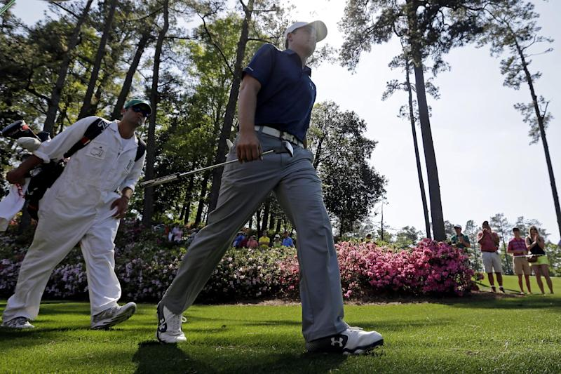 Jordan Spieth walks with his caddie Michael Greller to the sixth green during the third round of the Masters golf tournament Saturday, April 12, 2014, in Augusta, Ga. (AP Photo/Darron Cummings)