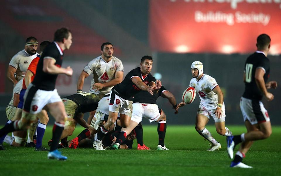 <p>Rhys Webb of Wales passes out from the back of the ruck</p>Getty