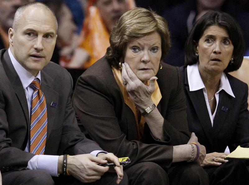 Tennessee head coach Pat Summitt, center, assistant coach Dean Lockwood, left, and Mickie DeMoss watch their team during the first half of an NCAA tournament second-round women's college basketball game against DePaul in Rosemont, Ill., Monday, March 19, 2012. (AP Photo/Nam Y. Huh)