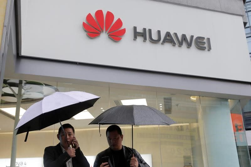 Huawei defends security record as annual sales top $100B
