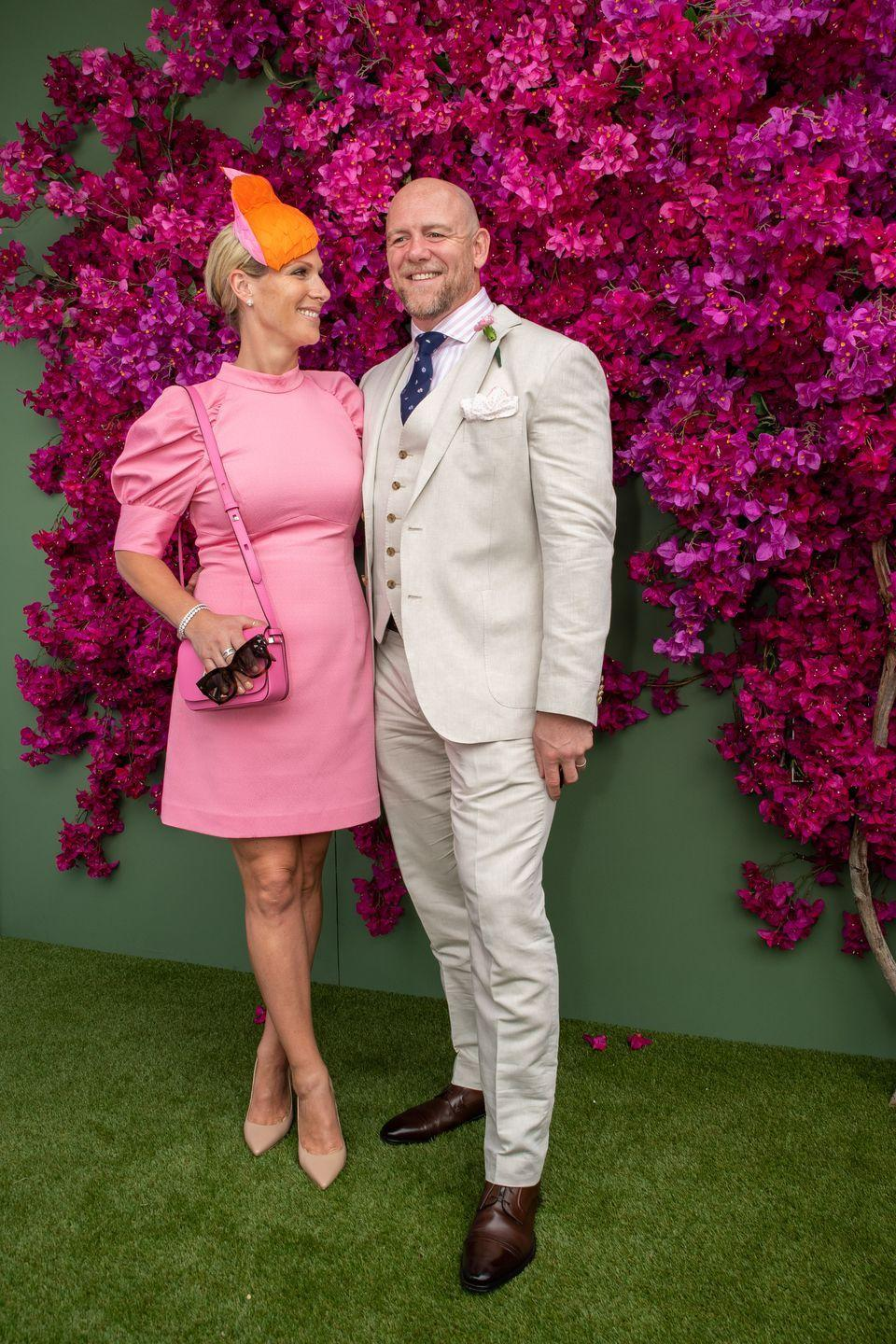 <p>Zara Phillips stepped out in a pink puff-sleeved dress for a day at the Moet Marquee Magic Millions Raceday in Australia with her husband Mike Tindall in January 2020. </p>