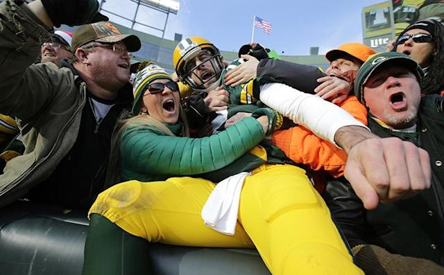 Dec 24, 2016; Green Bay, WI, USA; Green Bay Packers quarterback Aaron Rodgers celebrates his second quarter touchdown run with fans with a Lambeau Leap against the Minnesota Vikings at Lambeau Field. Mandatory Credit: Dan Powers/USA TODAY NETWORK-Wisconsin via USA TODAY Sports