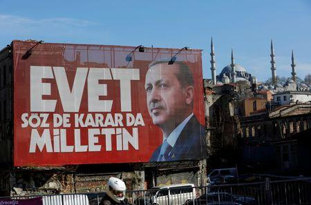 "A billboard carrying a picture of Turkish President Tayyip Erdogan and a slogan that reads: ""Yes. It is for the people to speak and to decide"" is seen on a building ahead of the constitutional referendum in Istanbul, Turkey April 13, 2017. REUTERS/Murad Sezer - RTX35F8G"