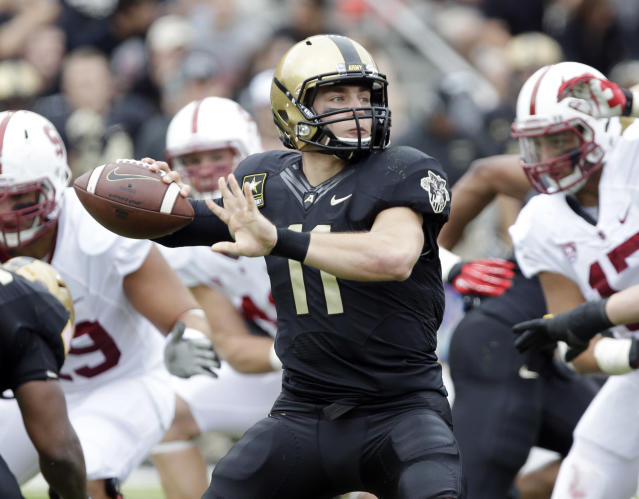 Army quarterback A.J. Schurr (11) passes against Stanford during the first half of an NCAA college football game on Saturday, Sept. 14, 2013, in West Point, N.Y. (AP Photo/Mike Groll)