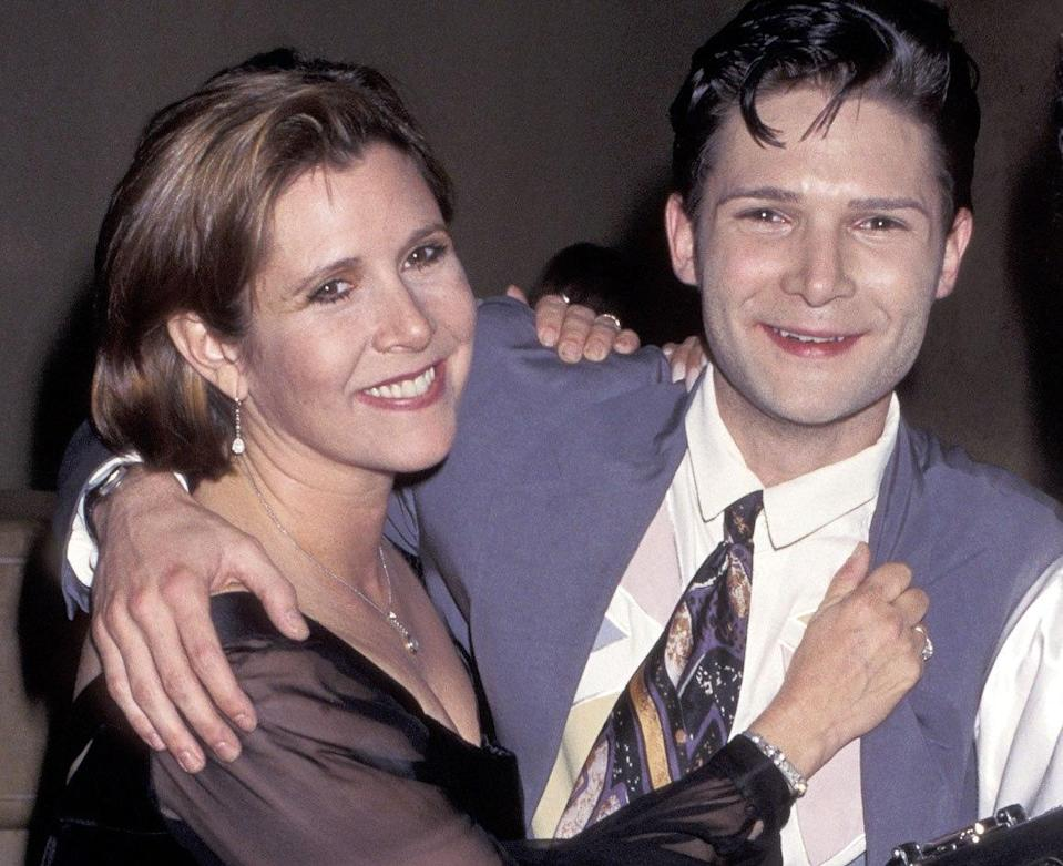 Carrie Fisher and Corey Feldman in 1996 (Credit: Jim Smeal/WireImage)